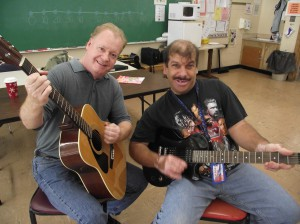 J. Girardin and S. Kelley playing guitar